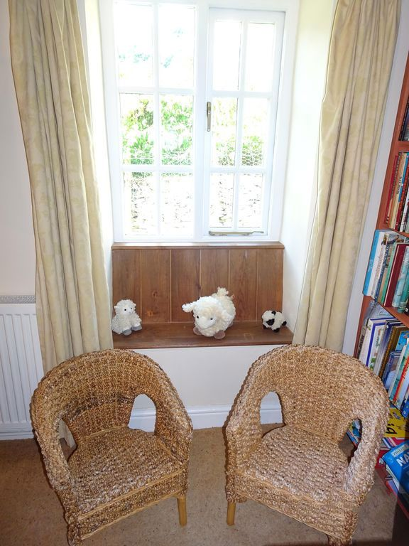 bookshelf chairs toys cottage